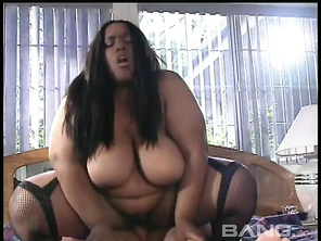 will amaze you with her flexibility and agility, as she takes off her corset and climbs up on top of her lover, who's laying on his back, as she squats down on his hard cock and rides it, while her massive knockers swing and bounce, before she gives him a