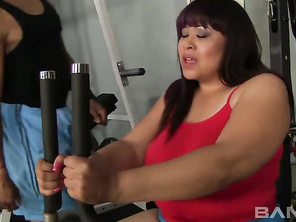 Mz Twilight is a sexy BBW, who happens to be part Asian and while at the gym working out on an exercise machine, her interracial trainer walks over and offers to finger her shaved pussy and play with her big tits.