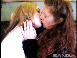 Lesbian girlfriends Jennifer Van Beaver and Monika Maple are sitting on their leather couch, giving you an upskirt as they get excited and begin kissing.