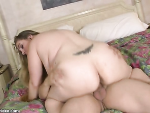 Big old tits resting on rolls of disgusting stomach fat