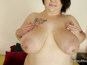 Sexy BBW Model Kitty McPherson is at Rodney's studio to do some lingerie modeling.