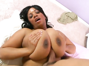He begins working her 36K wonder-tits over, squeezing them and burying his face in the softness.