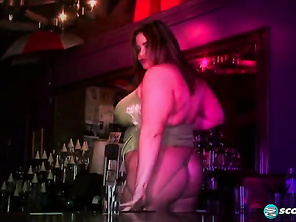 In the XLGirls DVD movie Brick House Brawds, sexy bartender Gia Johnson performs an ass-slapping exotic dance behind the bar.