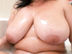 Look at how Sara holds up her huge and lovely 32FF tits for you to savor.