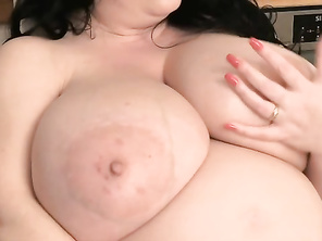 Natalie's big boobs are so much bigger now that she's knocked-up.