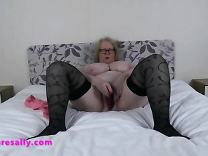 Mommy Sally fucks her cunt with a toy