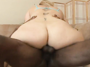 Depth comes in and she strokes his long black cock and takes it into her mouth, sucking him down deep while she feels his swollen nutsack.