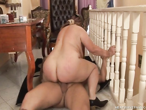 She doesn't even notice that she has left the door slightly ajar as she starts to finger herself, rubbing her clit with the palm of her hand and then bending over doggy on the chair to do herself from the back.
