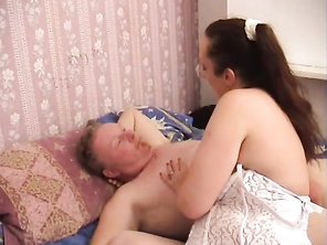 He lies there like a champion as she grinds her cunt on his cock, slipping the head inside her hole and then the entire shaft into her wet fuck slot.