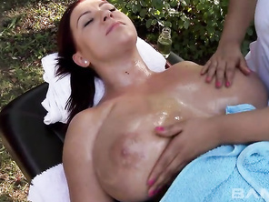 Topheavy redhead Anais invites her brunette buddy over to get a gentle afternoon massage in the back yard.