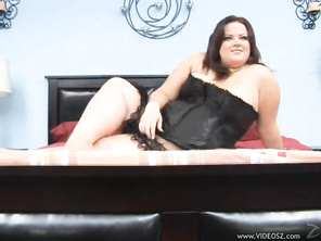 Trista Lace is a super-sized, sexy BBW wearing a black lace corset and lingerie, and she poses on the bed with her legs crossed so innocently.