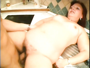 She spread wide and took his entire length into her hairy pussy, squeezing tight until he blew his wad all over that muff.