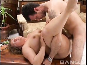 He fucks her on the couch from behind, then turns her around and squirts his jizz on her natural knockers.