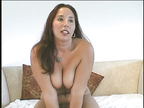 Lisa is a long, brunette haired BBW, that sits on her couch contemplating whether or not to continue with her decision to perform a solo masturbation in front of the camera.