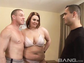 Stella's a BBW with reddish brunette hair, whose hubby just had an operation and can't have sex for at least a year so, he invites his best friend over to fuck his horny wife and after taking off her bra and panties, she gets down and gives this guy a blo