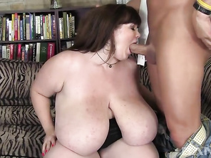 It may take a few minutes for the shock to wear off, once you've seen the 40 pounds of hooters, the horny, extra BBW Lexxxi Luxe is carrying around, before sitting on her couch to give her lover a deepthroat blowjob.