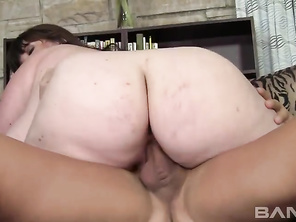 Next, she lays back and lets him fuck her totally shaved crack, until he pulls out and squirts a thick cumshot onto her knockers.