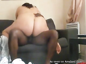 Brunette plumper rides black BF on the sofa.