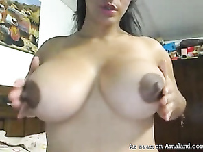 Latina cam chick shows off amazing curves.