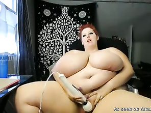 Monster boobed BBW playing with a vibrator.