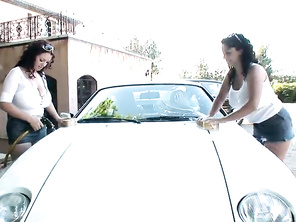 Watch as the two horny brunette lesbians Joanna Bliss and Michelle Monaghan, were told to go out and wash off the sports car they will be modeling next to until the one girl gets soap suds splashed on her deep cleavage and her girlfriend starts taking off