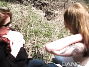 Two best friends, Jennifer Van Beaver and Monika Maple, take a walk in the woods where the older redheaded lesbian will attempt to win over her girlfriend as a full fledged lesbian.