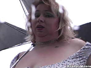 Blonde super BBW Kitty is walking in the Seattle rain in sexy and sassy outfit.