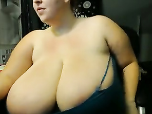 Chubby chick has massive natural tits