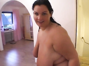 SSBBW walks naked from shower to scale