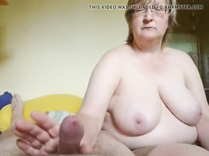 Plump grannie gives a jerking