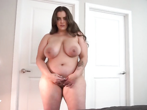 Chubby woman in the bedroom