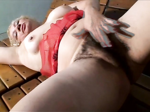 She spreads her pussy lips wide apart and he shoves his dick inside her gaping wide hole.