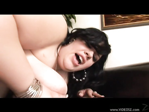 She takes care of this shaft and rides it hardcore, pleasuring her own shaved pussy before taking a thick load of cum on her huge natural boobs.