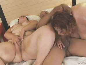 The cumshot happens after a titty fucking and some pussy screwing from behind.
